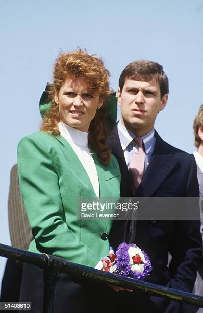 Prince Andrew and Sarah, Duchess of York watching a display by the Red Arrows during a visit to Jersey in the Channel Islands on May 2, 1987.