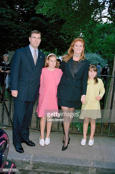 Prince Andrew, Duke of York, and Sarah, Duchess of York with their children, Princess Beatrice of York and Princess Eugenie of York, attending a...