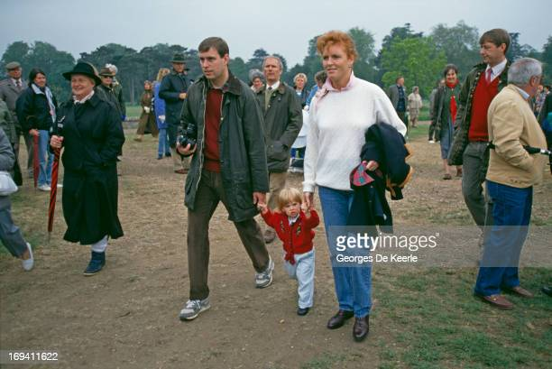 Prince Andrew Duke of York and Sarah Ferguson Duchess of York holding the hands of their daughter Princess Beatrice of York at the Royal Windsor...