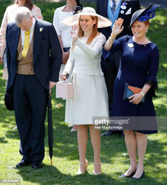 Prince Andrew Duke of York bows his head whilst Princess Beatrice and Sarah Duchess of York wave to Queen Elizabeth II as she and her guests pass by...