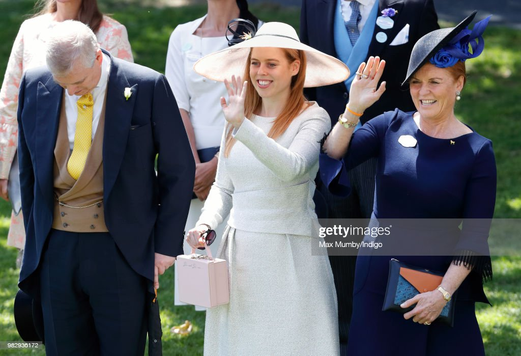 Prince Andrew, Duke of York bows his head whilst Princess Beatrice and Sarah, Duchess of York wave to Queen Elizabeth II as she and her guests pass by in horse drawn carriages on day 4 of Royal Ascot at Ascot Racecourse on June 22, 2018 in Ascot, England.