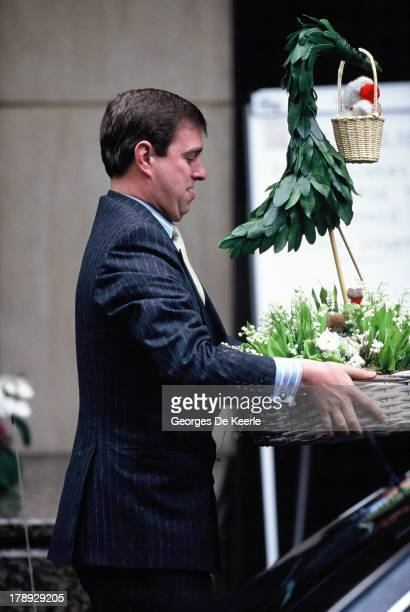 Prince Andrew Duke of York carries a basket of flowers to celebrate Princess Eugenie's birth in front of The Portland Hospital on March 24 1990 in...