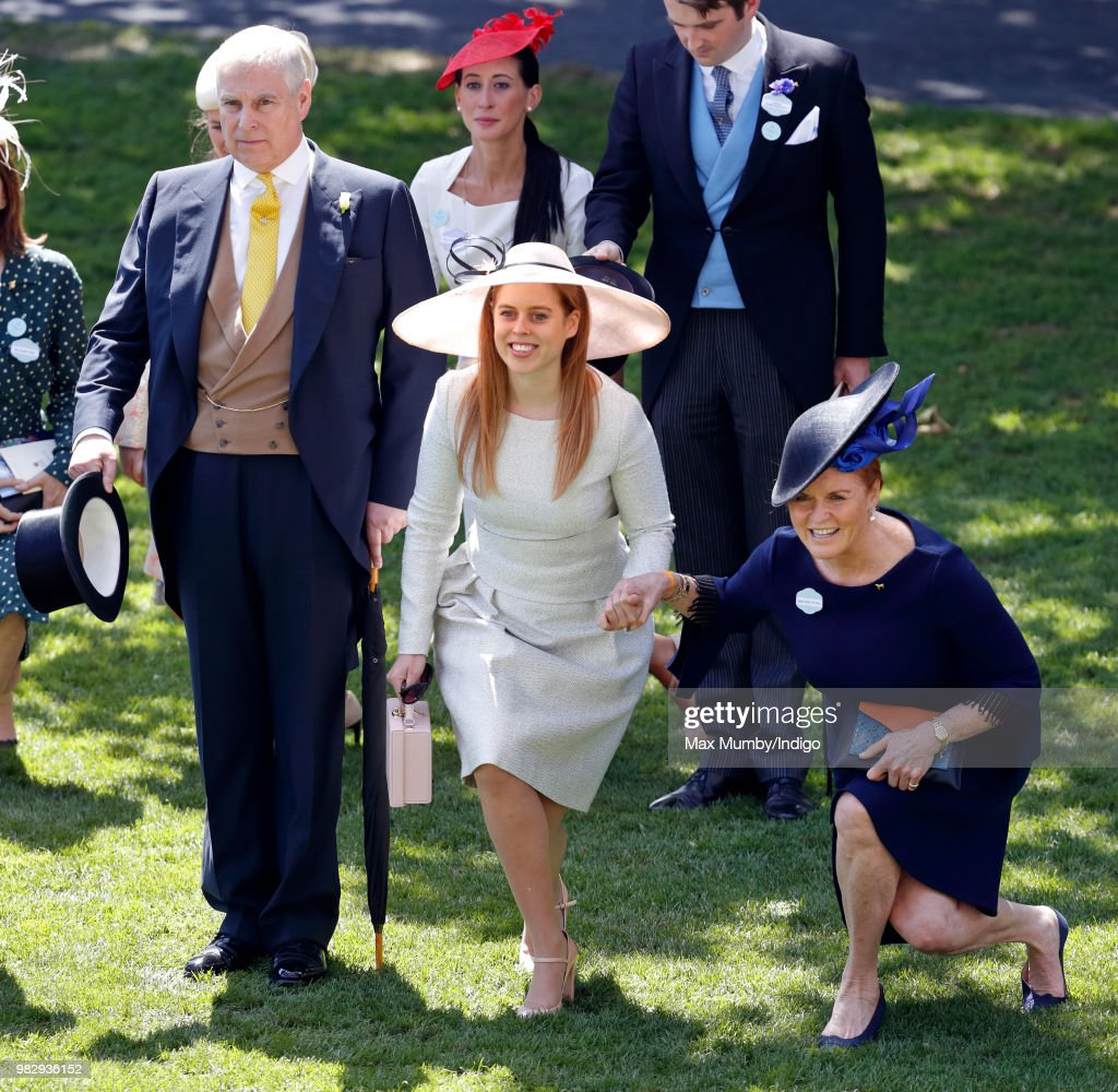 Prince Andrew, Duke of York doffs his top hat whilst Princess Beatrice and Sarah, Duchess of York curtsy to Queen Elizabeth II as she and her guests pass by in horse drawn carriages on day 4 of Royal Ascot at Ascot Racecourse on June 22, 2018 in Ascot, England.