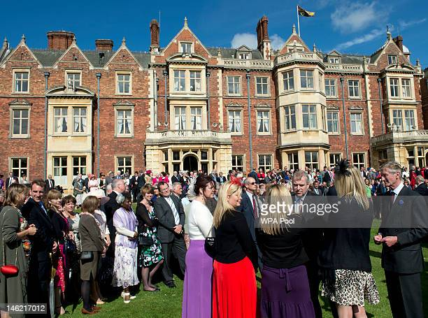 Prince Andrew, Duke of York greets guests at a garden party in honour of his mother Queen Elizabeth II's Diamond Jubilee at the Queen's Sandringham...