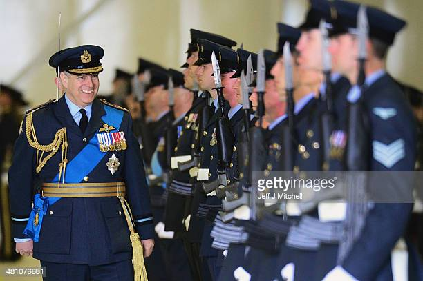 Prince Andrew Duke of York inspects RAF personnel from 617 squadron the Dambusters and their sister squadron 12 as they take part in a disbandment...
