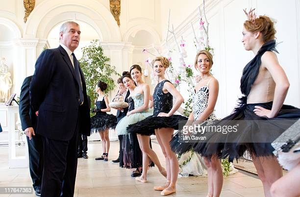Prince Andrew Duke of York is introduced to ballerinas by Managing Director Craig Hassall at the English National Ballet's summer party at The...