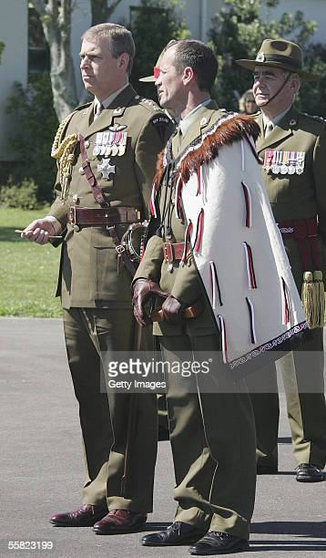 Prince Andrew Duke of York is lead through the Powhiri by Warrent Officer George Purvis before reviewing a parade of the 2nd Logistic Battalion at...