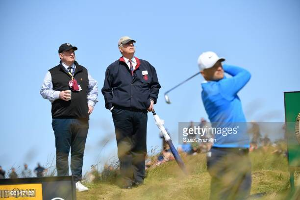 Prince Andrew, Duke of York looks on as Tom Lewis of England plays a shot during the third round of the 148th Open Championship held on the Dunluce...