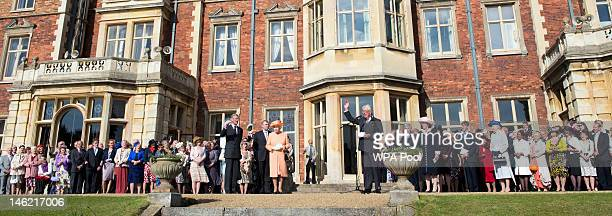 Prince Andrew, Duke of York looks on whilst Queen Elizabeth II receives a round of applause from guests to conclude a garden party in honour of her...
