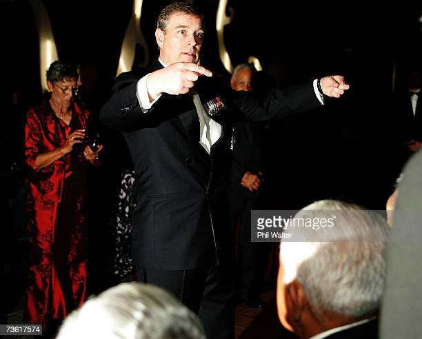 Prince Andrew Duke of York organises the seating for an official photo at the gala dinner in honour of the members of the 28th Maori Battalion at the...