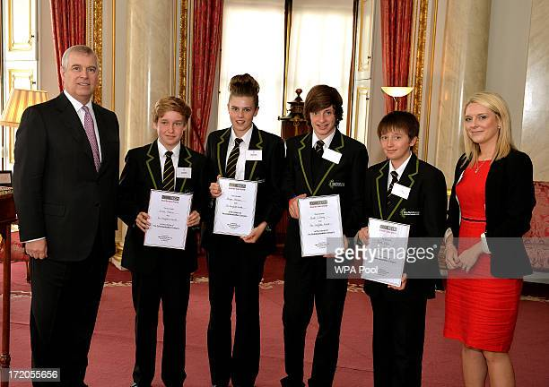 Prince Andrew Duke of York poses with Simon Palmer Megan Holmes Jack Lifsey Ryan Edlin and Teacher Lisa White from the Hayfield School in Doncaster...
