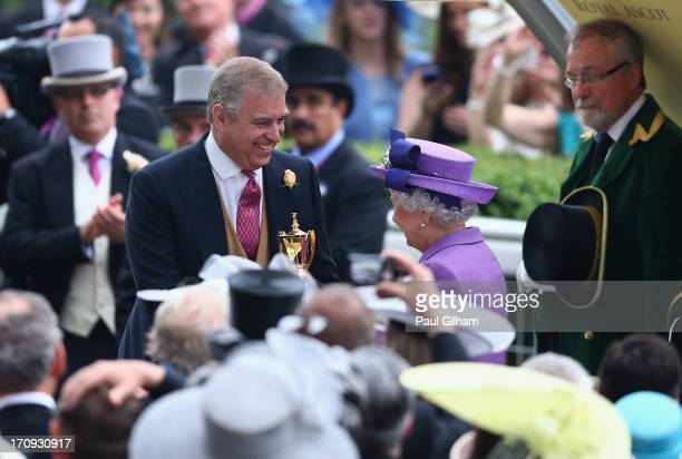 Prince Andrew Duke of York presents Queen Elizabeth II with The Gold Cup trophy after the Queen's horse Estimate ridden by Ryan Moore won The Gold...