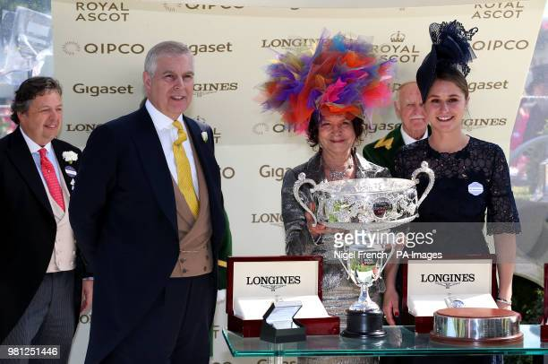 Prince Andrew Duke of York presents the trophies to owners the Niarchos Family after winning the Coronation Stakes with Alpha Centauri during day...