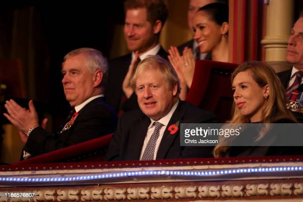 Prince Andrew, Duke of York, Prince Harry, Duke of Sussex, Meghan, Duchess of Sussex, Prime Minister, Boris Johnson and Carrie Symonds attend the...