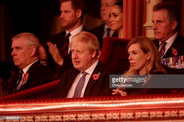 Prince Andrew Duke of York Prince Harry Duke of Sussex Meghan Duchess of Sussex Prime Minister Boris Johnson and Carrie Symonds attend the annual...