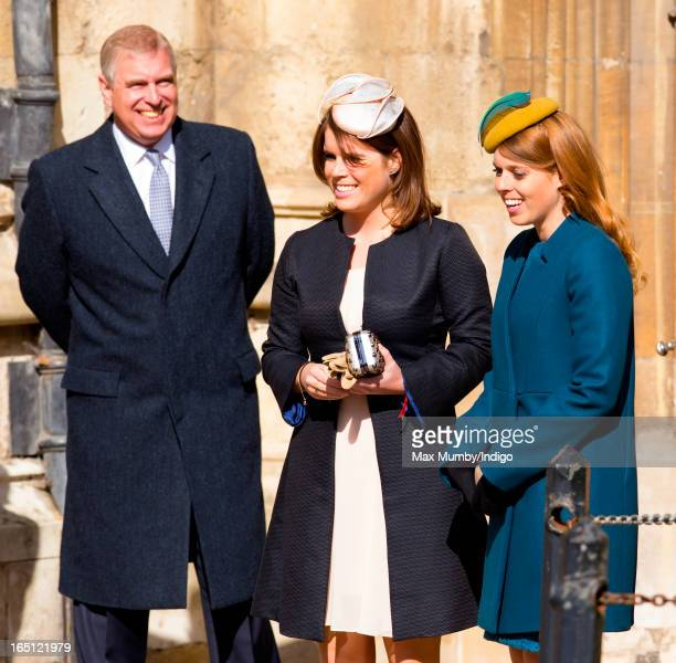Prince Andrew Duke of York Princess Eugenie and Princess Beatrice attend the Easter Matins Church Service at St George's Chapel Windsor Castle on...