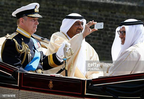 Prince Andrew Duke of York rides in a carriage with Sheikh Ahmed bin Saeed Al Maktoum President of the Department of Civil Aviation in Dubai and Dr...