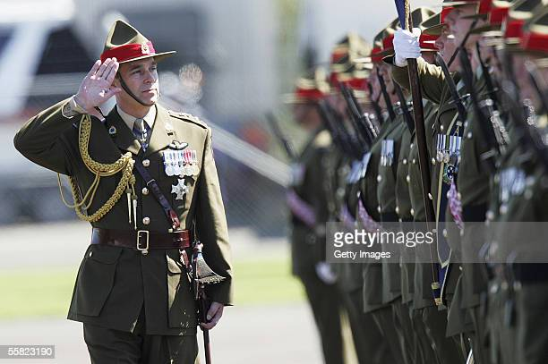 Prince Andrew Duke of York salutes as he reviews a parade of the 2nd Logistic Battalion after a Powhiri at Linton Army base September 29 2005 in...