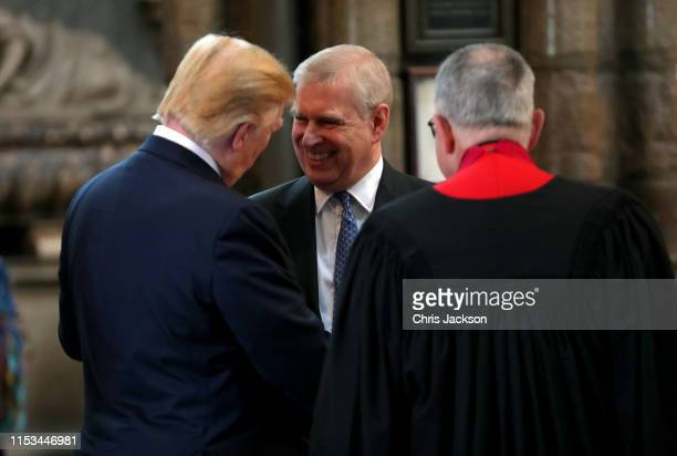 Prince Andrew Duke of York smiles and shakes hands with US President Donald Trump during the visit to Westminster Abbey on June 03 2019 in London...
