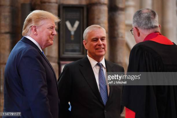 Prince Andrew Duke of York smiles with US President Donald Trump and Dean of Westminster John Hall during the visit to Westminster Abbey on June 03...