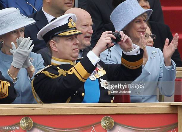 Prince Andrew Duke of York takes photos on a Leica compact camera as he attends the Armed Forces Parade and Muster on May 19 2012 in Windsor England...