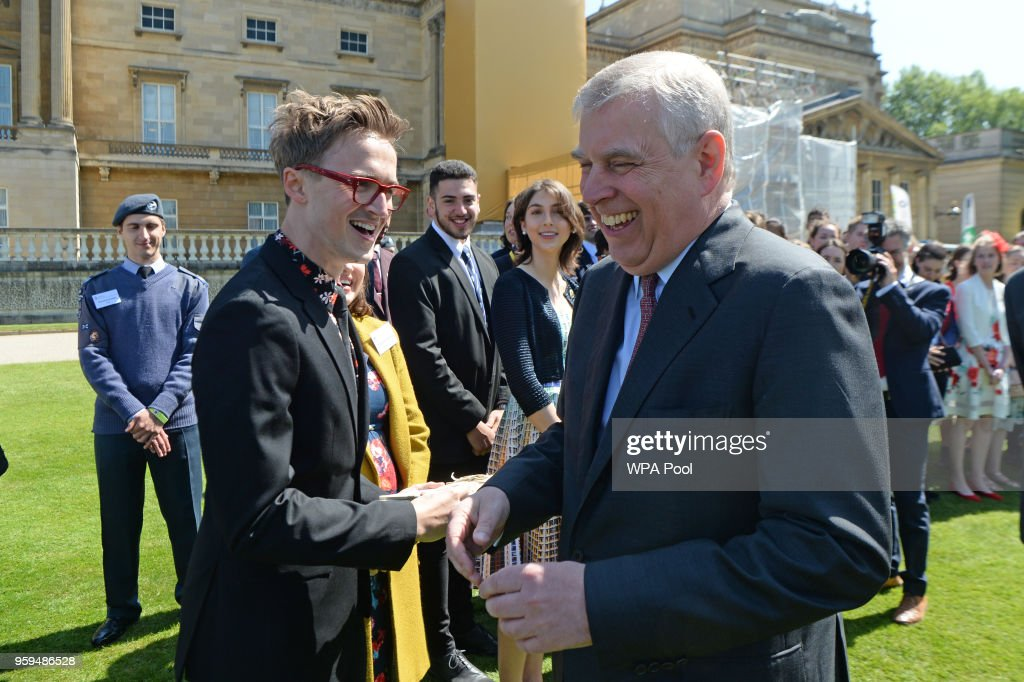 Prince Andrew, Duke of York talks to Tom Fletcher during a ceremony for the Duke of Edinburgh's Award in the gardens at Buckingham Palace on May 17, 2018 in London, England.