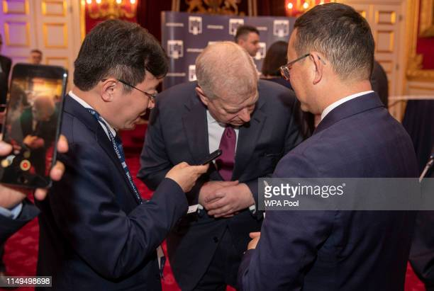 Prince Andrew Duke of York trials a new translator as he hosts a Pitch@Palace event at Buckingham Palace on June 12 2019 in London England