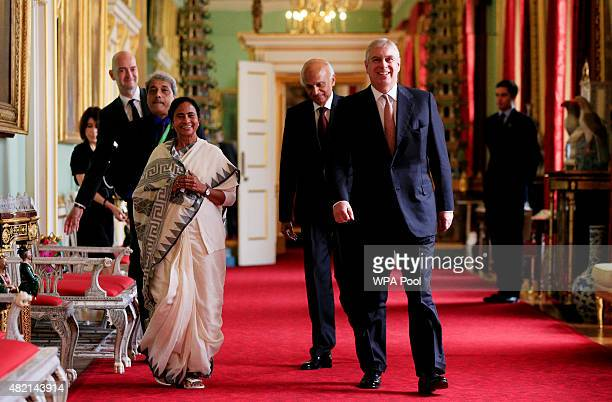 Prince Andrew, Duke of York walks with West Bengal Chief Minister Mamata Banerjee as he hosts a tea for those responsible for assisting with the...