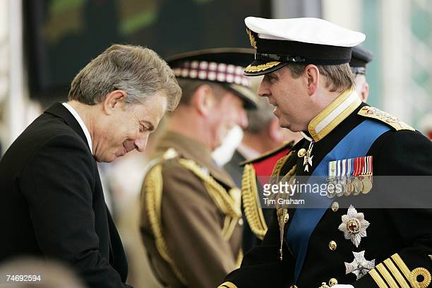 Prince Andrew Duke of York who served in the Royal Navy during the Falklands conflict in 1982 greets Prime Minister Tony Blair at a parade for...