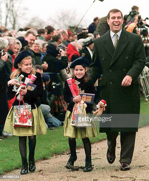 KINGDOM DECEMBER 25 Prince Andrew Duke of York with daughters Princess Beatrice and Princess Eugenie attend the annual Christmas Day service at...