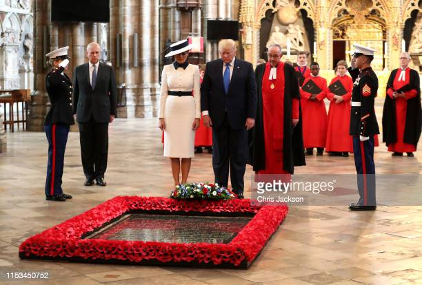 Prince Andrew Duke of York with US President Donald Trump First Lady Melania Trump and the Dean of Westminster John Hall at the Grave of the Unknown...