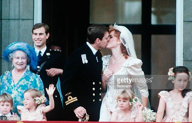 Prince Andrew is seen kissing Sarah Ferguson on the balcony after their wedding ceremony at Buckingham Palace in this photo Queen Elizabeth II and...