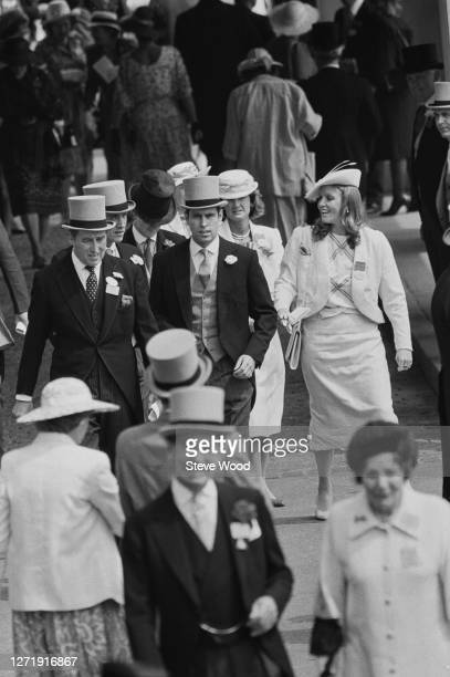 Prince Andrew later the Duke of York with his partner Sarah Ferguson and Lord Porchester at Royal Ascot in Berkshire UK 19th June 1985