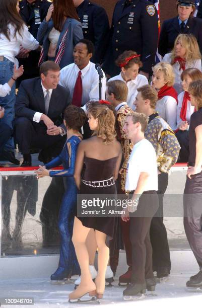 HRH Prince Andrew left talks with ice skaters after their performances during the 65th Opening of the Rink at Rockefeller Center