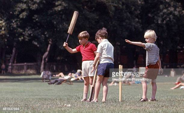 Prince Andrew playing cricket with friends in Holland Park London 17th July 1967