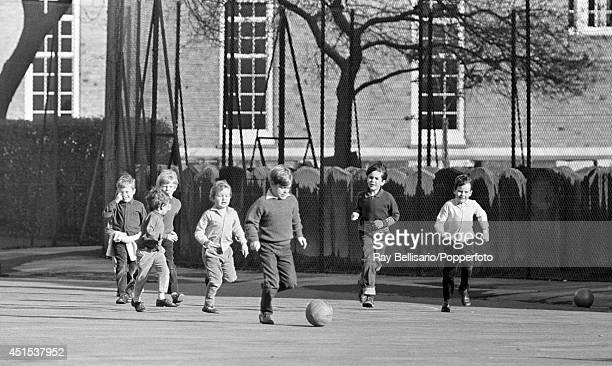 Prince Andrew playing football with his cousin Lord Linley and friends at St Lukes School playground in London on 17th October 1967