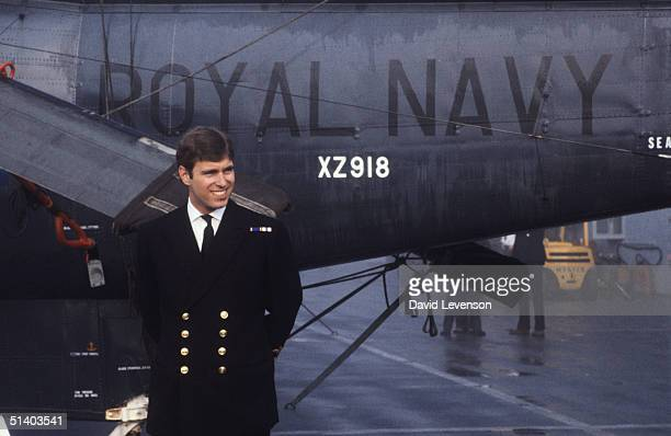 Prince Andrew returns from the Falklands War on September 17 on board HMS Invincible. He posed in front of the Sea King helicopter that he had flown...