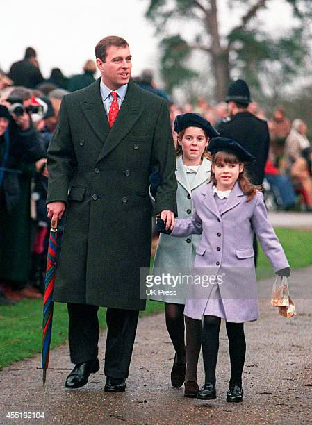 KINGDOM DECEMBER 25 Prince Andrew The Duke of York and daughters Princess Beatrice and Princess Eugenie attend the annual Christmas Day service at...