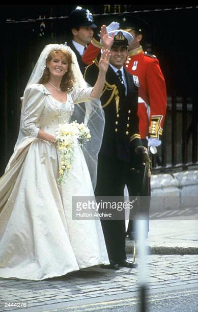 Prince Andrew, the Duke of York, and Sarah Ferguson wave outside of Buckingham Palace on their wedding day, London, England, July 23, 1986.