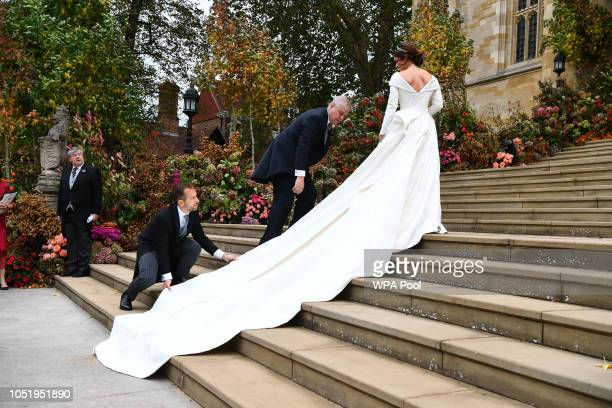 Prince Andrew the Duke of York arrives with Princess Eugenie for her wedding to Jack Brooksbank at St George's Chapel in Windsor Castle on October 12...