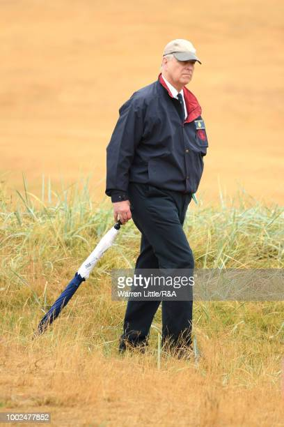 Prince Andrew The Duke of York looks on from the side of the 2nd fairway during round two of the Open Championship at Carnoustie Golf Club on July 20...