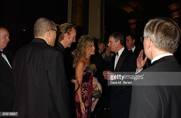 Prince Andrew the Duke of York meets musician Mike Rutherford and Angie Rutherford at the 'Russian Rhapsody' Royal Gala in the presence of Prince...