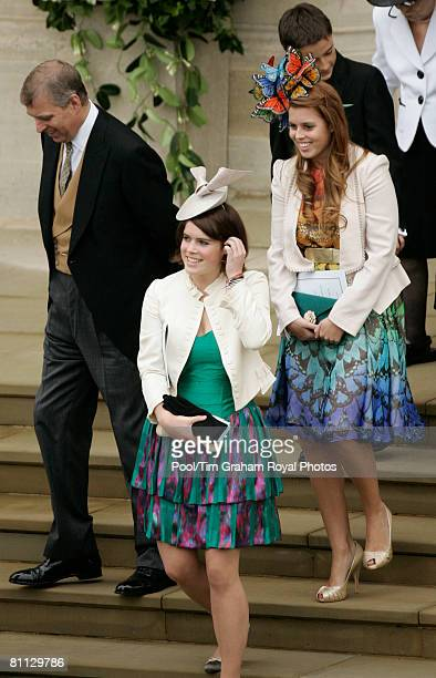 Prince Andrew the Duke of York walks with daughters Princess Eugenie and Princess Beatrice at the wedding of Peter Phillips to Autumn Kelly at St...