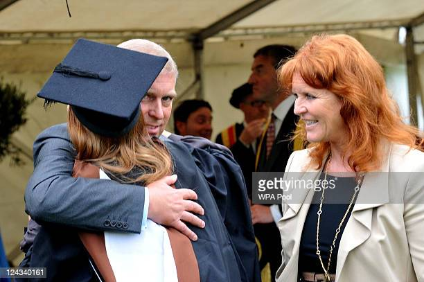 Prince Andrew the Duke York watched by Sarah Duchess of York hugs his daughter Princess Beatrice following her graduation ceremony at Goldsmiths...