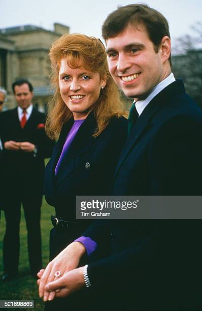 Prince Andrew with Sarah Ferguson at Buckingham Palace after the announcement of their engagement, London, 17th March 1986. Ferguson's white and...