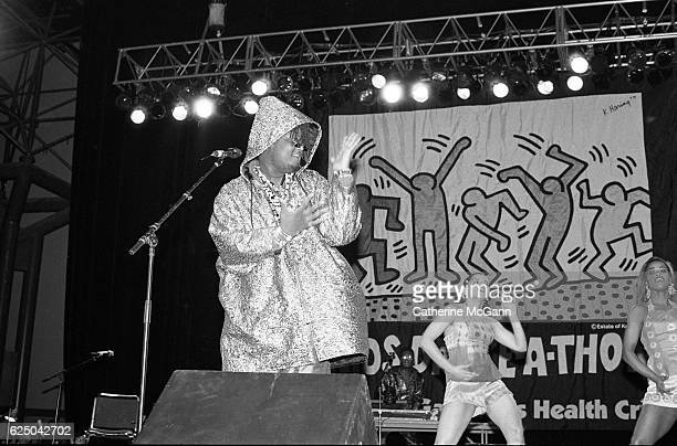 Prince Be of PM Dawn performs before a Keith Haring banner at AIDS DanceaThon on November 30th 1991 at Rosalind Ballroom in New York City New York