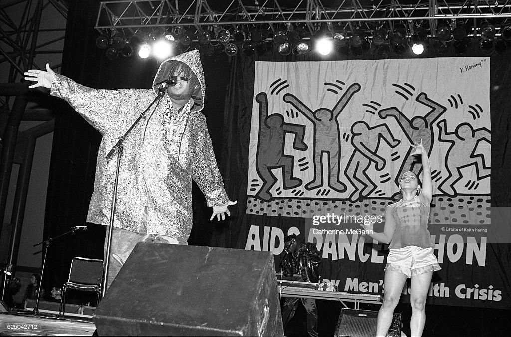 Prince Be (born Attrell Cordes, 1970 - 2106) of PM Dawn performs before a Keith Haring banner at AIDS Dance-a-Thon on November 30th, 1991 at Rosalind Ballroom in New York City, New York.
