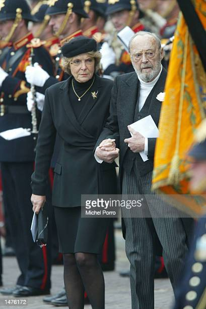Prince Bernhard father of Dutch Queen Beatrix and his daughter Princess Irene bow to the Dutch Royal standard after the funeral ceremony of Prince...