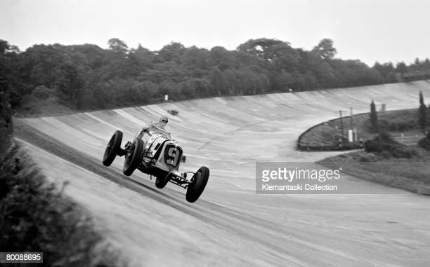 Prince Bira high on the banking over the bumps of the Campbell Circuit at Brooklands in his famous supercharged 3liter Maserati 8 cylinder during the...