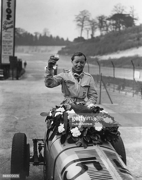 Prince Bira of Siam 'B Bira' celebrates winning the JCC International Trophy race driving the ERA R2B Romulus on 2 May 1936 at the Brooklands circuit...